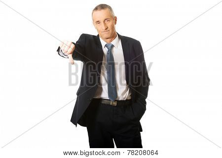 Disappointment businessman showing thumb down sign.
