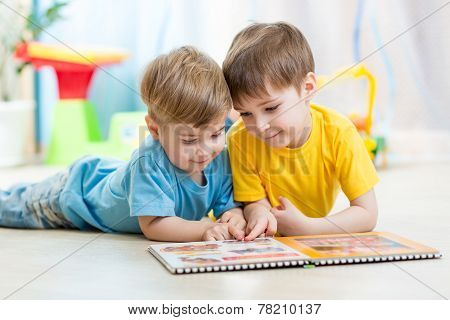 Kids Brothers Read A Book At Home