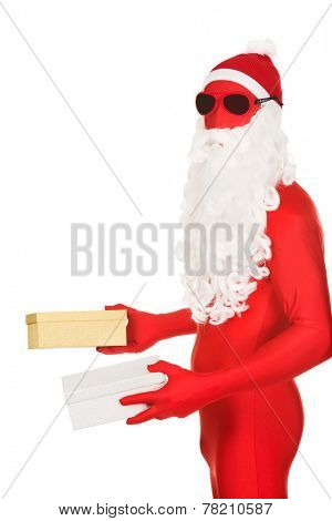 Side view santa in latex clothing holding gifts.