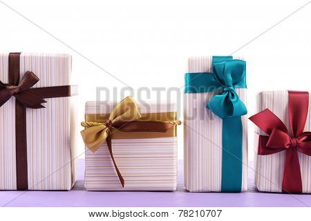 Cute presents on light blue uneven surface isolated on white