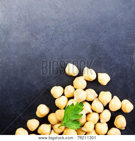 Heap Of Golden Chick Peas Close Up On Dark Background With Blank Copyspace For Your Text.  Chickpeas