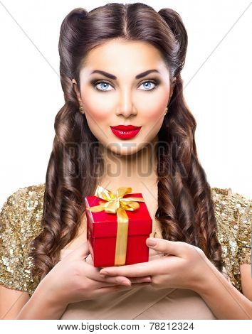 Beauty Pin up girl with holiday gift box in her hand. Retro woman portrait. Vintage styled make up and hairstyle. Pinup style lady isolated on a white background
