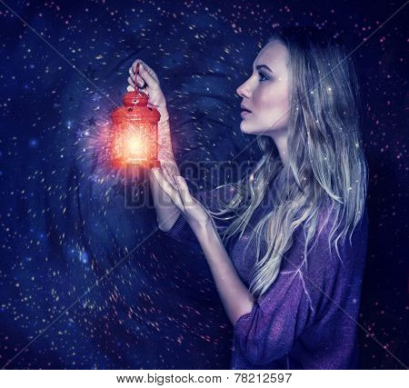 Beautiful woman with magic lantern on starry sky background, holding in hands red vintage lamp, antique festive attributes, Christmas holidays