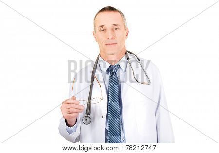 Portrait of mature male doctor holding his eyewear.