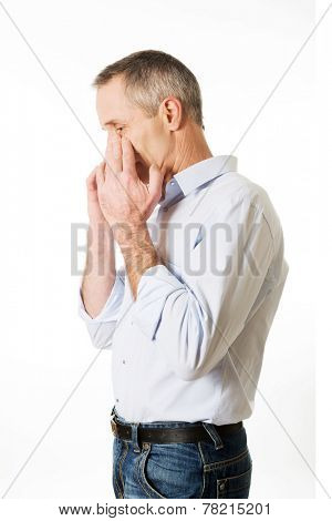 Side view mature man suffering from sinus pressure pain.