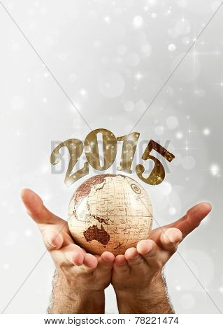 New Year over the globe earth hold by man`s hands