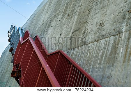 Metal Stairs On The Gray Concrete Wall