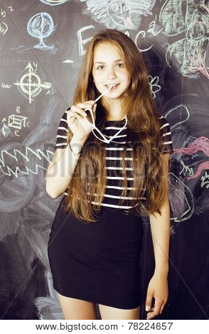 back to school after summer vacations, cute teen girl in classroom