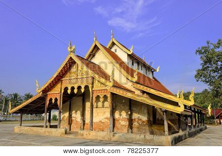 Old Thai Buddhist Temple And Blue Sky