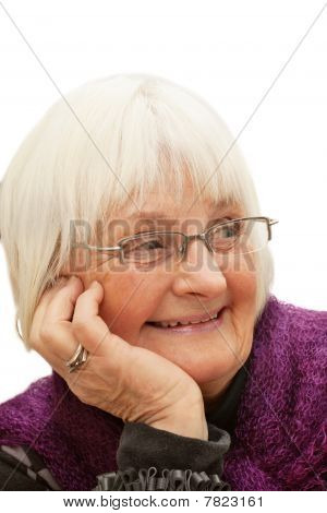 Portrait Of Smiling Old Woman Looking Away