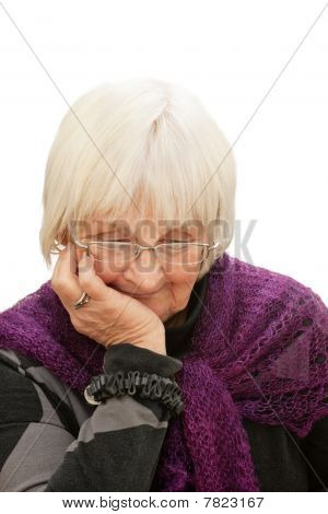 Portrait Of Thoughtful Senior Woman Looking Down