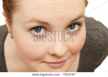 Pretty Face Of A Young Woman Looking At You