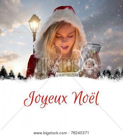 sexy santa girl opening gift against joyeux noel
