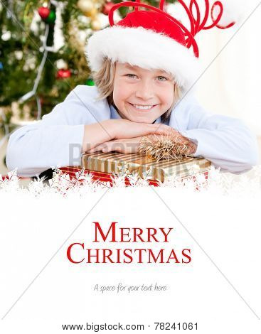 Adorable child celebrating christmas against merry christmas