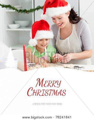 Lovely mother and daughter preparing Christmas cookies against merry christmas