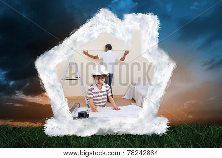 Father and son refurbishing home against green grass under blue and orange sky