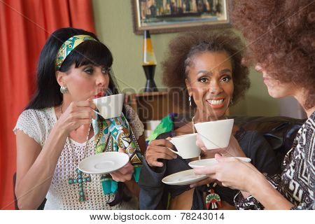Smiilng Mature Women Having Tea