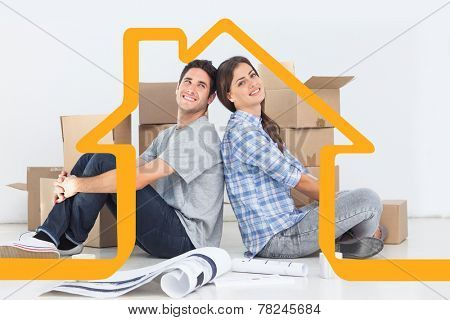 Beautiful couple sitting back-to-back against house outline