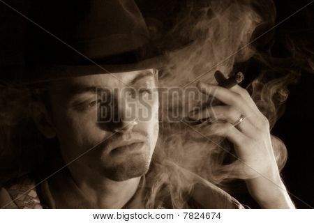 Man In Fedora Hat Smoking Sigar