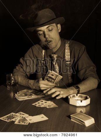 Old Style Gambler With Money And Cigar