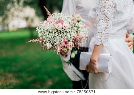 Wedding Bouquet In Groom's Hands Closeup