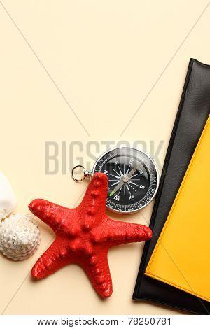 Compass, Seastar And Seashells On Notebook