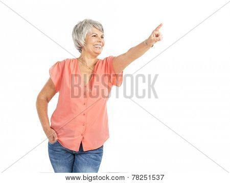 Happy old woman pointing to something