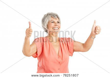 Portrait of a happy old woman with thumb up, isolated on a white background