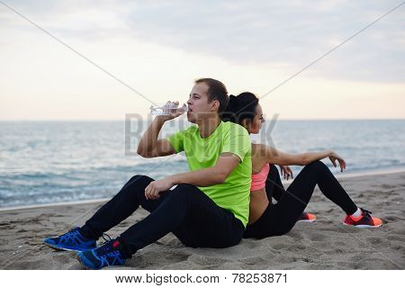 Young fit couple having break after workout outdoors,Young fit couple having break after workout