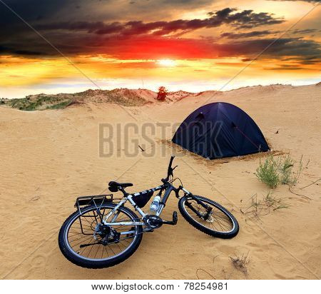 bike in tourist camp against sunset sky background