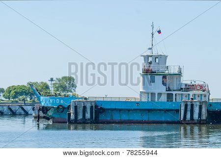 Nida ferry boat on spit for cars and people