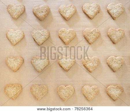 Heart-shaped Christmas cookies on baking paper