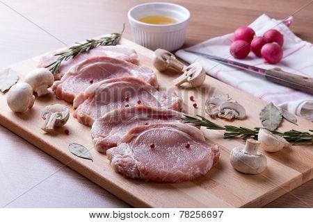 Pork tenderloin with champignon, rosemary, bay leaves and pepper