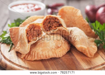 Fried empanada stuffed with ground beef, classic latin american appetizer