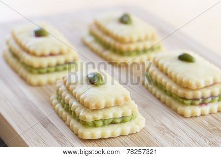 Christmas cookies arranged on a wooden board