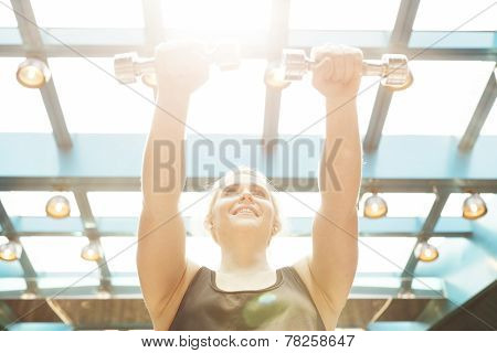 Girl working out with dumbells