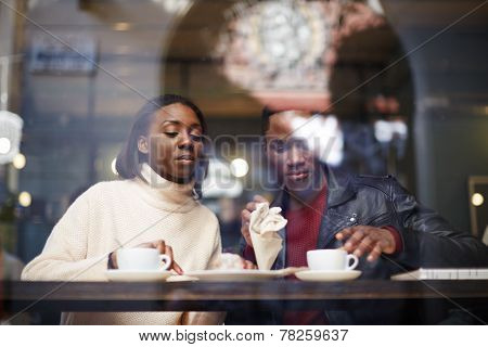 Two young friends talk and drink coffee in cafe good friend enjoying coffee in beautiful place