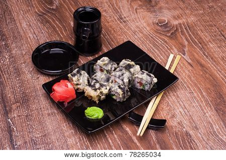 Tempura Sushi Roll With Ginger, Soy Sauce And Chopsticks