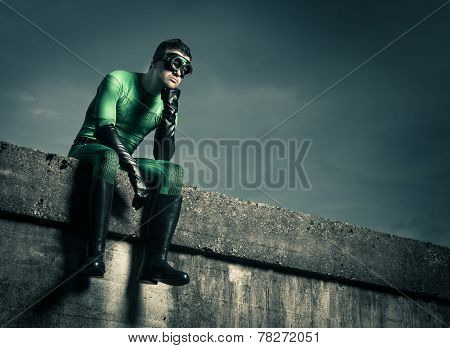 Pensive Superhero Against Dark Sky