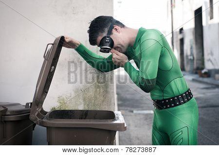 Superhero Opening A Trash Bin