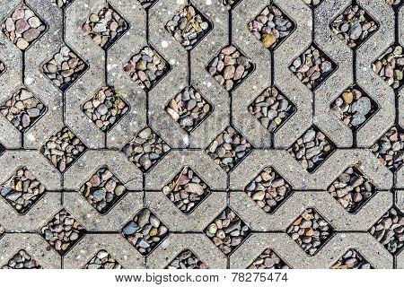 Background Of Concrete Stones With Pebble Stones Inlay