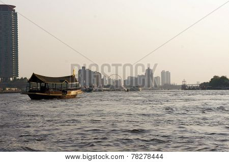 Traditional barge on Chao Phraya river in Bangkok