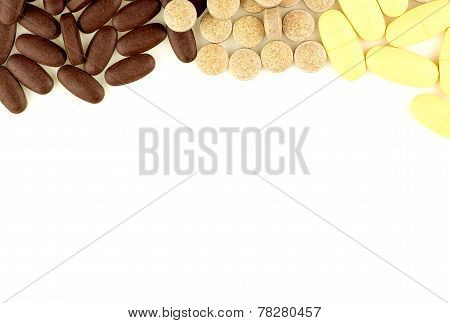 Multi Colored Pills Scattered On White Background With Aerial View