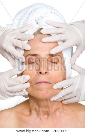 Senior Woman Face In Rubber Gloves Hands