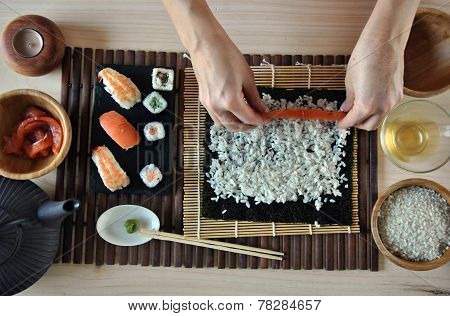 Hands Cooking Sushi