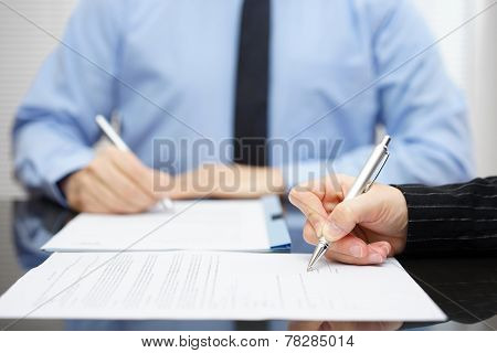 Man And Woman   Signing A Business Contract After The Conclusion Of The Negotiations