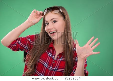 Student girl on green background