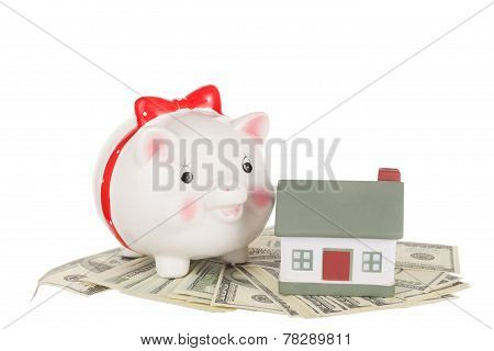 Pig moneybox cash and house.