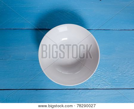 Empty Bowl On Blue Wooden Bird's Eye View