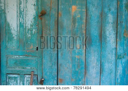 Blue Weathered Wooden Door With Rusty Lock